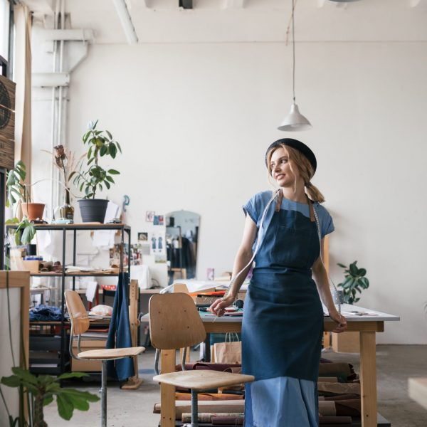 young-female-entrepreneur-in-her-workshop-BMTHTH6